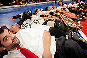 Senor Miguel Hunt, or Mike Hunt, manager of Putas del Fuego at the end of a team 'spoon' after defeating the Hellcats in a bout at Palmer Events Center in Austin, Texas.