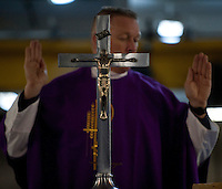 101205-N-7981E-021 PACIFIC OCEAN (Dec. 5, 2010)- Chaplain Cmdr. Keith Shuley, command chaplain of USS Carl Vinson (CVN 70), leads Sailors in prayer during Roman Catholic mass on Vinson's foc'sle. Carl Vinson and Carrier Air Wing 17 are currently on a three-week composite training unit exercise (COMPTUEX) followed by a western Pacific deployment. (U.S. Navy photo by Mass Communication Specialist 2nd Class James R. Evans / RELEASED)
