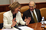 """Outgoing Israeli Prime Minister Ehud Olmert (R) and Foreign Minister and Kadima leader Tzipi Livni (L) attend the weekly cabinet meeting in the Knesset in Jerusalem, Sunday, February 22, 2009. In the meeting, Ehud Olmert congratulated Likud leader Benjamin Netanyahu for being entrusted with the """"complex"""" task of forming a coalition and urged him to act as quickly and as efficiently as possible in creating the government. Photo By: Tess Scheflan / JINI."""
