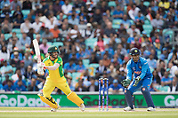 David Warner (Australia) cuts to point during India vs Australia, ICC World Cup Cricket at The Oval on 9th June 2019