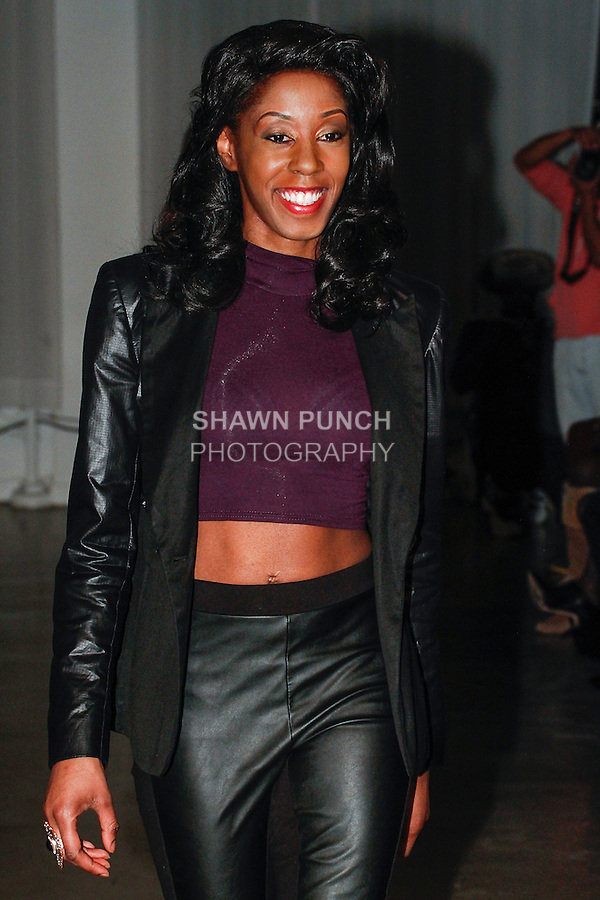 Fashion designer Chantell Walters walks runway at the close of her Chantell Walters Fall Winter 2014 collection fashion show, at 320 West 37th Street, in New York City, during New York Fashion Week Fall 2014, February 7, 2014.