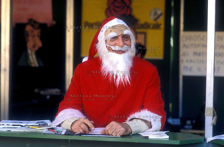 Leader of the Italian Radical party Marco Pannella  dressed as Santa Claus in Piazza Navona for the Radical Party on December 28, 1995 in Rome, Italy.