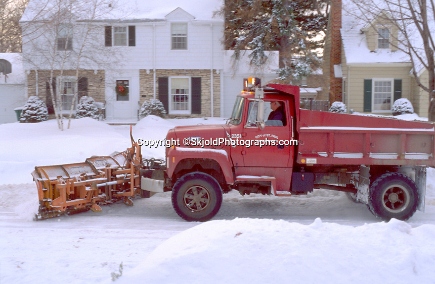 City plow truck clearing away snow after heavy fall. St Paul Minnesota USA