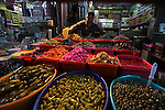 A Palestinian vendor sells pickles at a market in Gaza City as the faithful prepare for the start of the Muslim holy fasting month of Ramadan on June 17, 2015. More than 1.5 billion Muslims around the world will mark the month, during which believers abstain from eating, drinking, smoking and having sex from dawn until sunset. Photo by Ashraf Amra