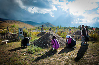 The mother (kneeling, right), sister (middle) and boyfriend (left) of Urus Kasymbay mourn at her grave. Urus killed herself after she was kidnapped by Imonakunov Seitbek. He was eventually sentenced to  six years for the crime of kidnapping a woman and rape. Although illegal, bride kidnapping is common in rural parts of Kyrgyzstan. Although illegal, bride kidnapping is common in rural parts of Kyrgyzstan. Each year around 16, 000 women become married after being kidnapped. They are known as 'Ala Kachuu' that translates as 'to grab and run away'. Defenders of the continuation of the practice sight tradition. However, during Soviet Times it was rare, and parents generally arranged marriages..