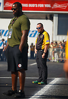 Jun 9, 2017; Englishtown , NJ, USA; NHRA announcer Brian Lohnes (right) and Philadelphia Eagles defensive tackle Fletcher Cox watch NHRA qualifying for the Summernationals at Old Bridge Township Raceway Park. Mandatory Credit: Mark J. Rebilas-USA TODAY Sports