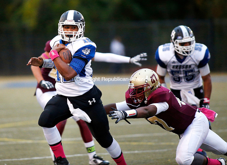 Waterbury, CT- 01 October 2015-100115CM01-  Crosby's Mike Marshall carries the ball as Sacred Heart's Tiron Ferris attempts the tackle during their NVL matchup in Waterbury on Thursday.    Christopher Massa Republican-American