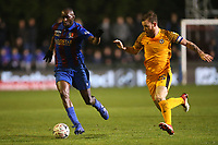 Stephane Ngamvoulou of Maldon and Mark O'Brien of Newport County during Maldon & Tiptree vs Newport County, Emirates FA Cup Football at the Wallace Binder Ground on 29th November 2019