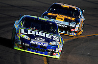 Apr 11, 2008; Avondale, AZ, USA; NASCAR Sprint Cup Series driver Jimmie Johnson leads Matt Kenseth during practice for the Subway Fresh Fit 500 at Phoenix International Raceway. Mandatory Credit: Mark J. Rebilas-