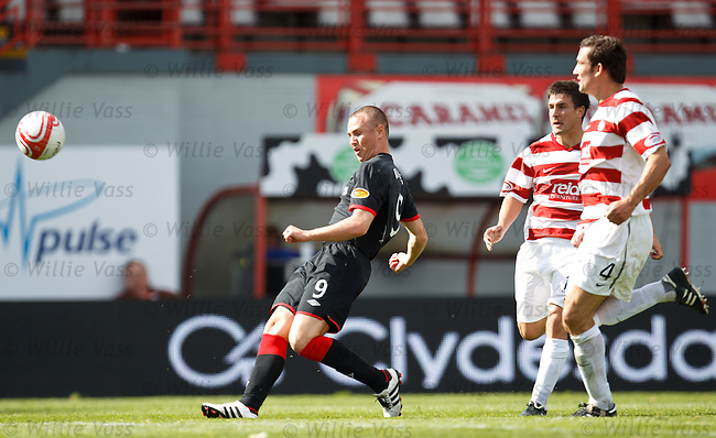 Kenny Miller shrugs off the challenge of David Buchanan to fire in Rangers winning goal