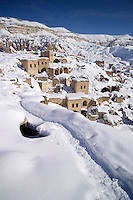 Goreme, Cappadocia, Nevsehir, Turkey, winter 2005. The old village of Cavusun is built in the rocks. The Valleys of the Goreme National Park offer some very good snow shoeing. Many people who visit in the summer do not realize that temperatures in winter can go as low as minus 25 celcius, with a meter of snow on the ground.Photo by Frits Meyst / MeystPhoto.com