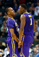 PITTSBURGH, PA - MARCH 19:  Jarell Martin #1 of the LSU Tigers reacts with teammate Tim Quarterman #55 after a play against the North Carolina State Wolfpack in the first half during the second round of the 2015 NCAA Men's Basketball Tournament at Consol Energy Center on March 19, 2015 in Pittsburgh, Pennsylvania.  (Photo by Jared Wickerham/Getty Images)