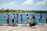 Family fishing off the jetty at Horn Island, Torres Strait Islands, Queensland, Australia