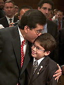 Judge Alberto R. Gonzales, Attorney General-designate is kisses his son Gabriel, 9, prior to his confirmation hearing before the United States Senate Judiciary Committee in Washington, D.C. on January 6, 2005.  Gonzales has been nominated by United States President George W. Bush to replace John Ashcroft as head of the United States Department of Justice.<br /> Credit: Ron Sachs / CNP