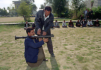 Men are given weapons training in a park. UN weapons inspectors in February 1998 look for WMDs (weapons of mass destruction), as the population in Iraq prepared for an armed conflict.   The UNSCOM weapons inspectors left Iraq later that year.<br /> <br /> <br /> <br /> ©Fredrik Naumann/Felix Features