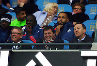 Swansea City chairman Huw Jenkins (right) looks on from the stand during the Barclays Premier League match between Manchester City and Swansea City played at the Etihad Stadium, Manchester on December 12th 2015