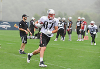 Wednesday, July 27, 2016: New England Patriots tight end Rob Gronkowski (87) runs after making the catch at a joint training camp practice between New England Patriots and  the New Orleans Saints  training camp held Gillette Stadium in Foxborough Massachusetts. Eric Canha/CSM