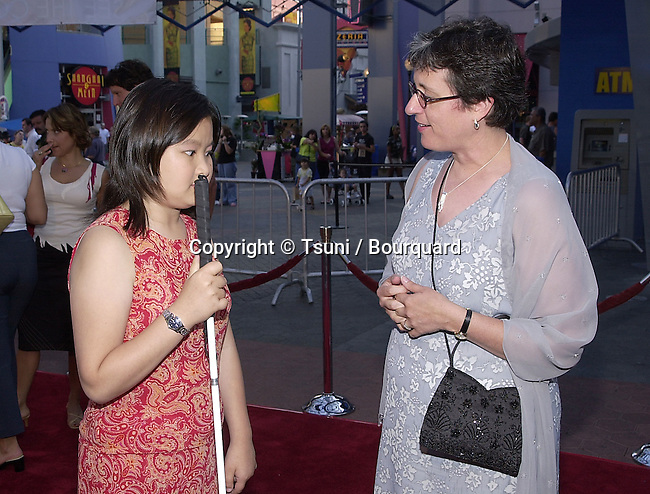Dionne Quan (blind actress, voice of Kimmi Wanatabe ) and the coordinator of the event arriving at the Jurassic Park 3-screening for a new setting for people with visual or audio impairments - . The screening was at the Universal City Walk in Los Angeles. July 24, 2001  © Tsuni          -            QuanDionne_KayLaurie01.jpg