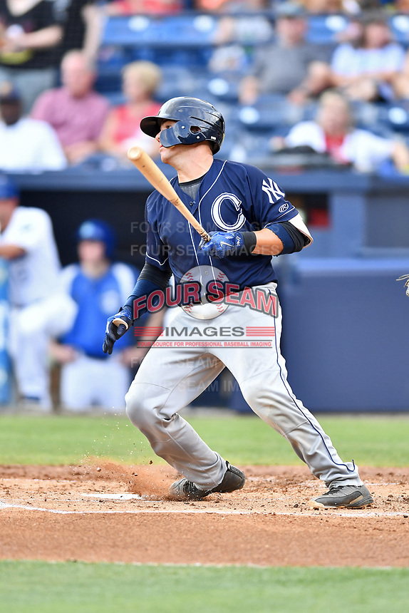 Charleston RiverDogs catcher Donny Sands (15) swings at a pitch during a game against the Asheville Tourists at McCormick Field on July 4, 2017 in Asheville, North Carolina. The Tourists defeated the RiverDogs 2-1. (Tony Farlow/Four Seam Images)