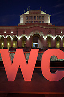 """Armenia. Yerevan. Republic Square. A huge orange sign in front of the the History Museum and the National Gallery. The letters are the first two letters of World Congress On Information Technology (WCIT), which is an information and communications technology (ICT) event which took place from October 6 to 9, 2019. The 23ʳᵈ World Congress on IT featured discussions related to the evolution of the Digital Age. Yerevan, sometimes spelled Erevan, is the capital and largest city of Armenia. Republic Square (known locally as Hraparak, """"the square"""") is the central town square. It consists of two sections: an oval roundabout and a trapezoid-shaped section which contains a pool with musical fountains. The square was originally designed by Alexander Tamanian in 1924. The construction of most of the buildings was completed by the 1950s; the last building—the National Gallery—was completed in 1977. During the Soviet period it was called Lenin Square. 12.10.2019 © 2019 Didier Ruef"""