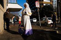 JOHANNESBURG, SOUTH AFRICA - JULY 20:  A nun walks down a Johannesburg street in South Africa.  (Photo by Landon Nordeman)