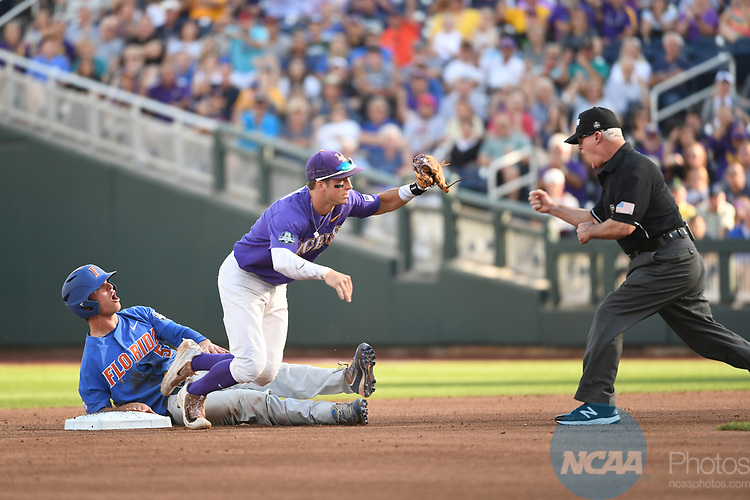 OMAHA, NE - JUNE 26: Cole Freeman (8) of Louisiana State University jumps up in excitement after tagging out Dalton Guthrie (5) of the University of Florida at second base during the Division I Men's Baseball Championship held at TD Ameritrade Park on June 26, 2017 in Omaha, Nebraska. The University of Florida defeated Louisiana State University 4-3 in game one of the best of three series.  (Photo by Justin Tafoya/NCAA Photos via Getty Images)