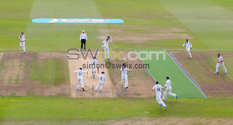 Picture by Alex Whitehead/SWpix.com - 12/09/2014 - Cricket - LV County Championship Div One - Nottinghamshire CCC v Yorkshire CCC, Day 4 - Trent Bridge, Nottingham, England - Yorkshire players celebrate the final wicket taken by Ryan Sidebottom that won them the Championship trophy.