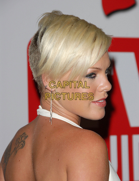 PINK .attend The 4th Annual TV Guide Post Emmy Party held at Social in Hollywood, California, USA, August 27 2006..portrait headshot tattoos white halterneck dress pinnk short hair shoulder back emmys.Ref: DVS.www.capitalpictures.com.sales@capitalpictures.com.©Debbie VanStory/Capital Pictures