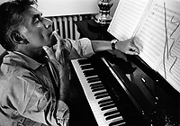 Composer and conductor, Leonard Bernstein at his piano.