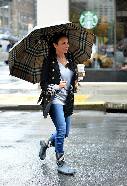 WWW.ACEPIXS.COM<br /> <br /> June 1 2015, New York City<br /> <br /> TV personality Danielle Staub walks in the rain with her Burberry umbrella on June 1 2015 in New York City<br /> <br /> By Line: Curtis Means/ACE Pictures<br /> <br /> <br /> ACE Pictures, Inc.<br /> tel: 646 769 0430<br /> Email: info@acepixs.com<br /> www.acepixs.com