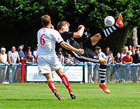 Lincoln City's Sean Raggett attempts an overhead kick under pressure from Lincoln United's Sean Wright<br /> <br /> Photographer Chris Vaughan/CameraSport<br /> <br /> Football - Pre-Season Friendly - Lincoln United v Lincoln City - Saturday 8th July 2017 - Sun Hat Villas Stadium - Lincoln<br /> <br /> World Copyright &copy; 2017 CameraSport. All rights reserved. 43 Linden Ave. Countesthorpe. Leicester. England. LE8 5PG - Tel: +44 (0) 116 277 4147 - admin@camerasport.com - www.camerasport.com