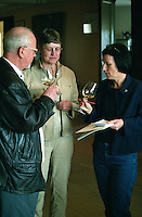 Visiting wine tasters tasting the white wine, discussing and taking notes, Chateau Puech-Haut, Saint-Drezery, Coteaux du Languedoc, Languedoc-Roussillon, France