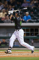 Danny Hayes (20) of the Charlotte Knights follows through on his swing against the Columbus Clippers at BB&T BallPark on May 3, 2016 in Charlotte, North Carolina.  The Clippers defeated the Knights 8-3.  (Brian Westerholt/Four Seam Images)