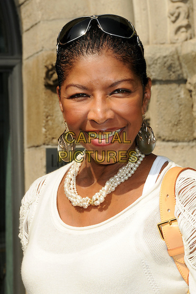NATALIE COLE<br /> Lloyd Klein Couture Fall 2010 Presentation held at Lloyd Klein House of Couture, Los Angeles, California, USA, 24th  March 2010.<br /> portrait headshot white necklace earrings  pearls pearl <br /> CAP/ADM/BP<br /> &copy;Byron Purvis/AdMedia/Capital Pictures