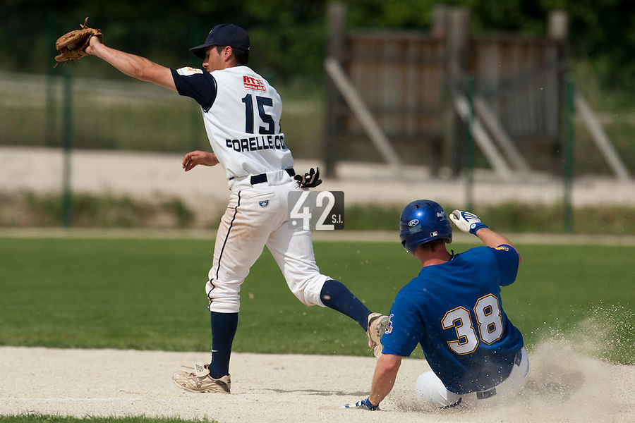 22 May 2009: Andrew Smith of Senart slides safely into second base as Julien Fachan  of Montpellier catches the ball during the 2009 challenge de France, a tournament with the best French baseball teams - all eight elite league clubs - to determine a spot in the European Cup next year, at Montpellier, France. Senart wins 7-1 over Montpellier.