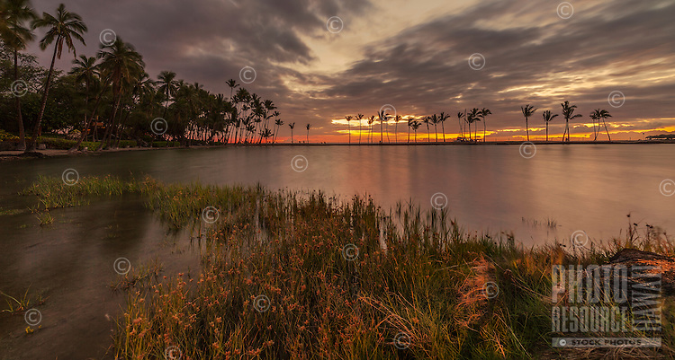A peaceful and colorful sunset at ʻAnaehoʻomalu Bay on the Big Island of Hawai'i.