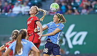 Portland, Oregon - Saturday July 2, 2016: Portland Thorns FC midfielder Dagny Brynjarsdottir (11) and Sky Blue FC midfielder Sarah Killion (16) go up for a header during a regular season National Women's Soccer League (NWSL) match at Providence Park.