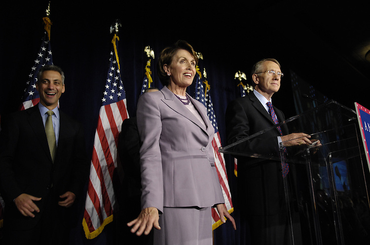 11/07/06--At an election party in Washington, D.C., near the U.S. Captiol, DCCC Chairman Rahm Emanuel, D-Ill., House Minority Leader Nancy Pelosi, D-Calif., and Senate Minority Leader Harry Reid, D-Nev., celebrate the Democratic takeover of the House, and potentially the Senate. Voters across the country dispatched Republican lawmakers Tuesday in favor of Democrats, ending four years of total GOP control in Congress and giving voice to a party that has challenged President BushÕs leadership of the war in Iraq. California Rep. Nancy Pelosi will become the highest-ranking woman ever in American government if, as expected, she is elected Speaker of the House in January. She is poised to lead Democrats as they move to check BushÕs authority and convince voters that they deserve to keep control of the chamber Ñ and take back the Oval Office Ñ in 2008. Congressional Quarterly Photo by Scott J. Ferrell