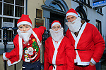 Alex, Andrew and James Healy at the Drogheda Christmas Bonanza santa parade<br /> Picture: Fran Caffrey www.newsfile.ie