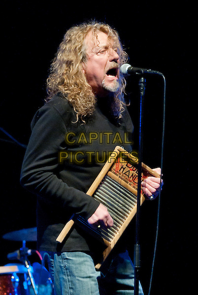 "ROBERT PLANT .Robert Plant (of Led Zepplin fame) performs in concert at a stop on his ""Band of Joy Tour"" held at the Peterson Events Center, University of Pittsburgh, Pittsburgh, PA, USA, 19th January 2011..half length music concert gig live on stage black polo neck jeans singing  microphone     playing board instrument             .CAP/ADM/DS.©Devin Simmons/AdMedia/Capital Pictures."