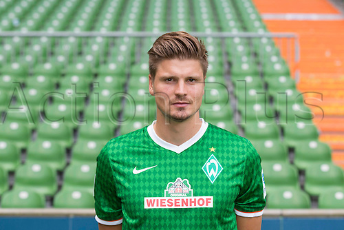 29.07.2013. Bremen, Germany.  The picture shows German Soccer Bundesliga club SV Werder Bremen's Sebastian Proedl during the official photocall for the season 2013-14 in Bremen.