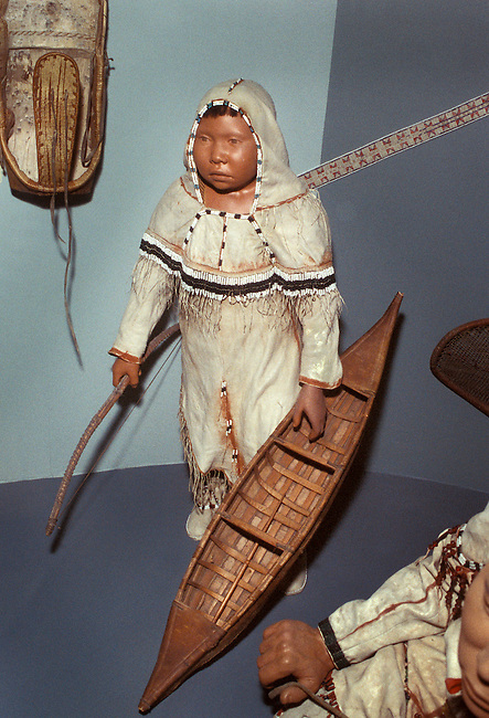 Clothing of the Sub Arctic Indians was made from caribou hide and decorated with beadwork. Boy carries a minature birch bark canoe