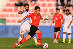 Hwang Heechan of South Korea (R) fights for the ball with Komail Hasan Alaswad of Bahrain (L) during the AFC Asian Cup UAE 2019 Round of 16 match between South Korea (KOR) and Bahrain (BHR) at Rashid Stadium on 22 January 2019 in Dubai, United Arab Emirates. Photo by Marcio Rodrigo Machado / Power Sport Images