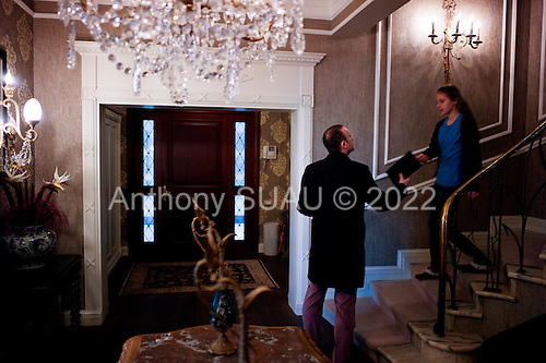 Istanbul, Turkey<br /> March 12, 2011<br /> <br /> At the entrance to their Yenik&ouml;y home Hazal hands an iPad to her father Alphan Manas, a technology and innovation expert, is chairman of Brightwell Holdings and a founder of and investor in many companies. Previously, he was a partner in Teknoloji Holding. He has invested heavily in energy and IT businesses, adding value and enabling their sale to strategic partners. Mr. Manas has worked on projects for developing countries, in conjunction with a range of institutions and university technology transfer centers in Turkey and the US. He is a board member of the Institute of Ecolonomics, a US-based non-profit organisation that promotes economic sustainability of rural areas by assisting local production and supply of energy, food, housing and other resources. He was chairman of the World Future Society and founded the Turkish Futurists Association, of which he is honorary chairman. He is also a founding member of the Turkish Business and Sustainable Development Association. He graduated in textile and apparel engineering from the University of the Aegean, Greece, and subsequently gained a master's degree in production management from the State University of New York.