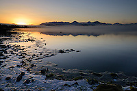 The sun rises over the Kenai Mountains and Skilak Lake during an early winter morning in Alaska's Kenai National Wildlife Refuge.