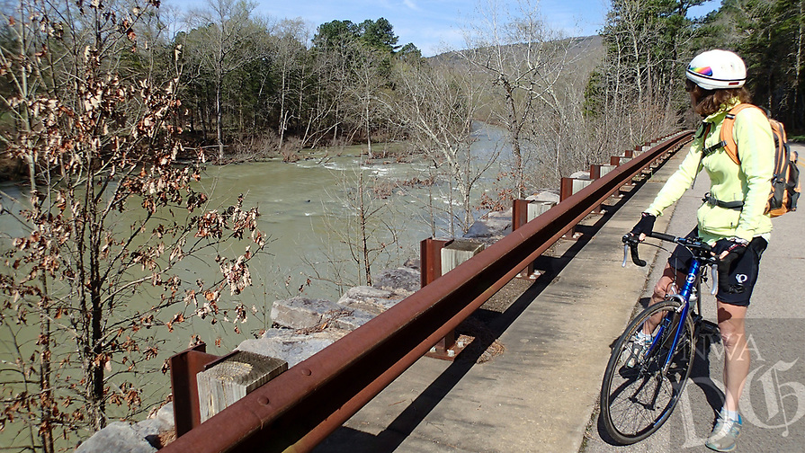 NWA Democrat-Gazette/FLIP PUTTHOFF <br /> Karen Mowry takes in a view of the Mulberry River from the Mulberry River Road Scenic Byway on March 26 2017. The route runs parallel to the river along Arkansas 215. A bike ride from Redding campground to Catalpa and back is 34 miles.