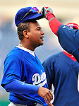 23 April 2010: Los Angeles Dodgers' third baseman Ronnie Belliard has his hat lifted to see his haircut prior to a game against the Washington Nationals at Nationals Park in Washington, DC. The Nationals defeated the Dodgers 5-1 in the first game of their 3-game series. Mandatory Credit: Ed Wolfstein Photo