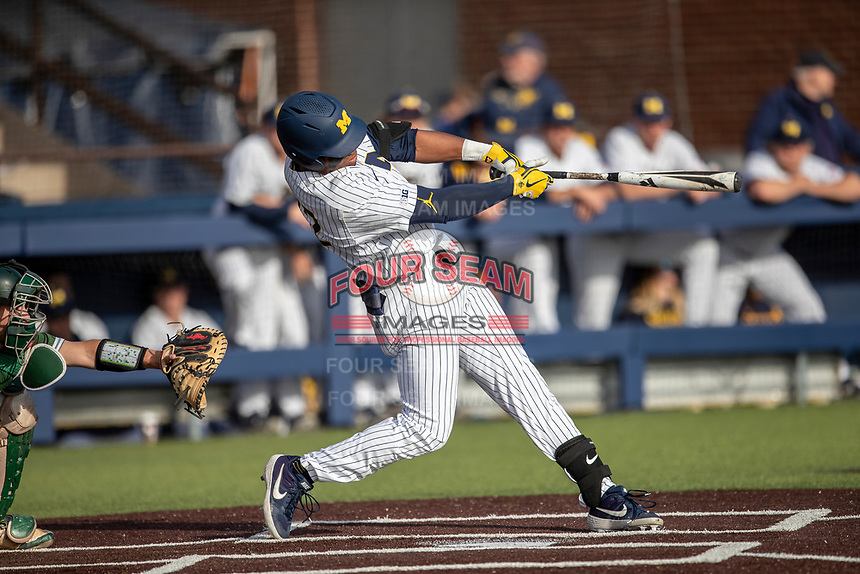 Michigan Wolverines outfielder Jordan Nwogu (42) swings the bat during the NCAA baseball game against the Eastern Michigan Eagles on May 8, 2019 at Ray Fisher Stadium in Ann Arbor, Michigan. Michigan defeated Eastern Michigan 10-1. (Andrew Woolley/Four Seam Images)