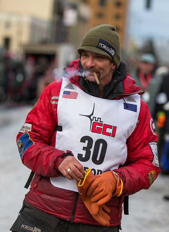Lance Mackey, a veteran Iditarod musher, prepares himself for the ceremenial start of the 43rd Annual Iditarod in Anchorage, Alaska. The 1000 mile dog sled race usually restarts in Willow, Alaska, and finishes in Nome. Poor snowfall, however, forced the restart north to Fairbanks.