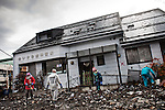 A devastating six-metre-high tsunami sweeps into the port city of Kamaishi in north-east Japan following an earthquake of up to 8.9 magnitude on march 11th..Kamaishi famous breakwater was in the Guinness World Records as the deepest on the planet. It was a product of decades of research on wave dynamics and dissipation. But the tsunami made short work of it and destroied half part of the city. Volunteers came from all over Japan to help and Clean the City, 27th March, 2011.